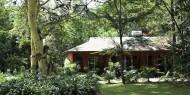 Jardines y habitaciones del Olasiti Lodge, Arusha, Tanzania